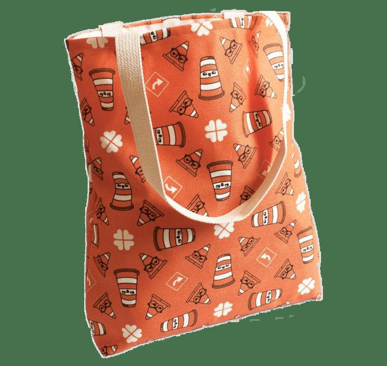 Un sac fourre-tout orange avec des dessins de Ponto