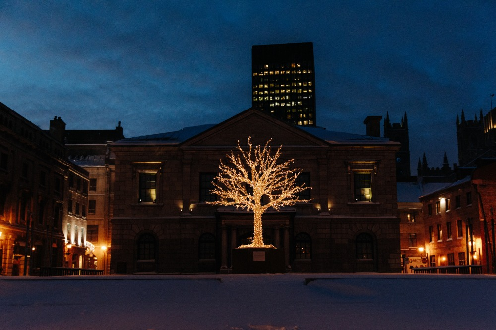 Luminous tree sitting on Place Royale in front of the Old Custom House